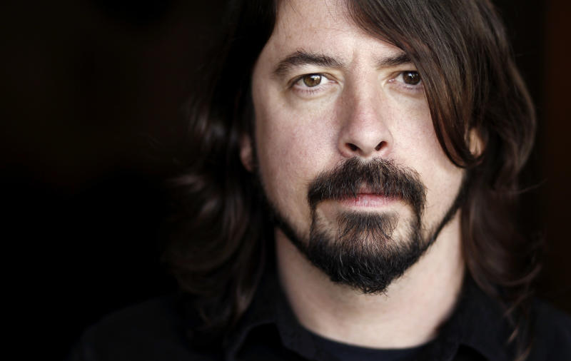 FILE - In this Jan. 31, 2012 file photo, musician Dave Grohl poses for a portrait in Los Angeles. The often eloquent Foo Fighters frontman has signed on to give the keynote speech at the 2013 South By Southwest Music Conference on March 14 in Austin, Texas. He's also working on his Sound City documentary and new Queens Of The Stone Age material with Josh Homme. Both are expected to be early released early next year. (AP Photo/Matt Sayles, file)