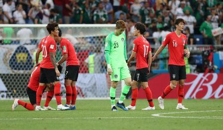 Soccer Football - World Cup - Group F - South Korea vs Mexico - Rostov Arena, Rostov-on-Don, Russia - June 23, 2018 South Korea players look dejected after the match REUTERS/Marko Djurica