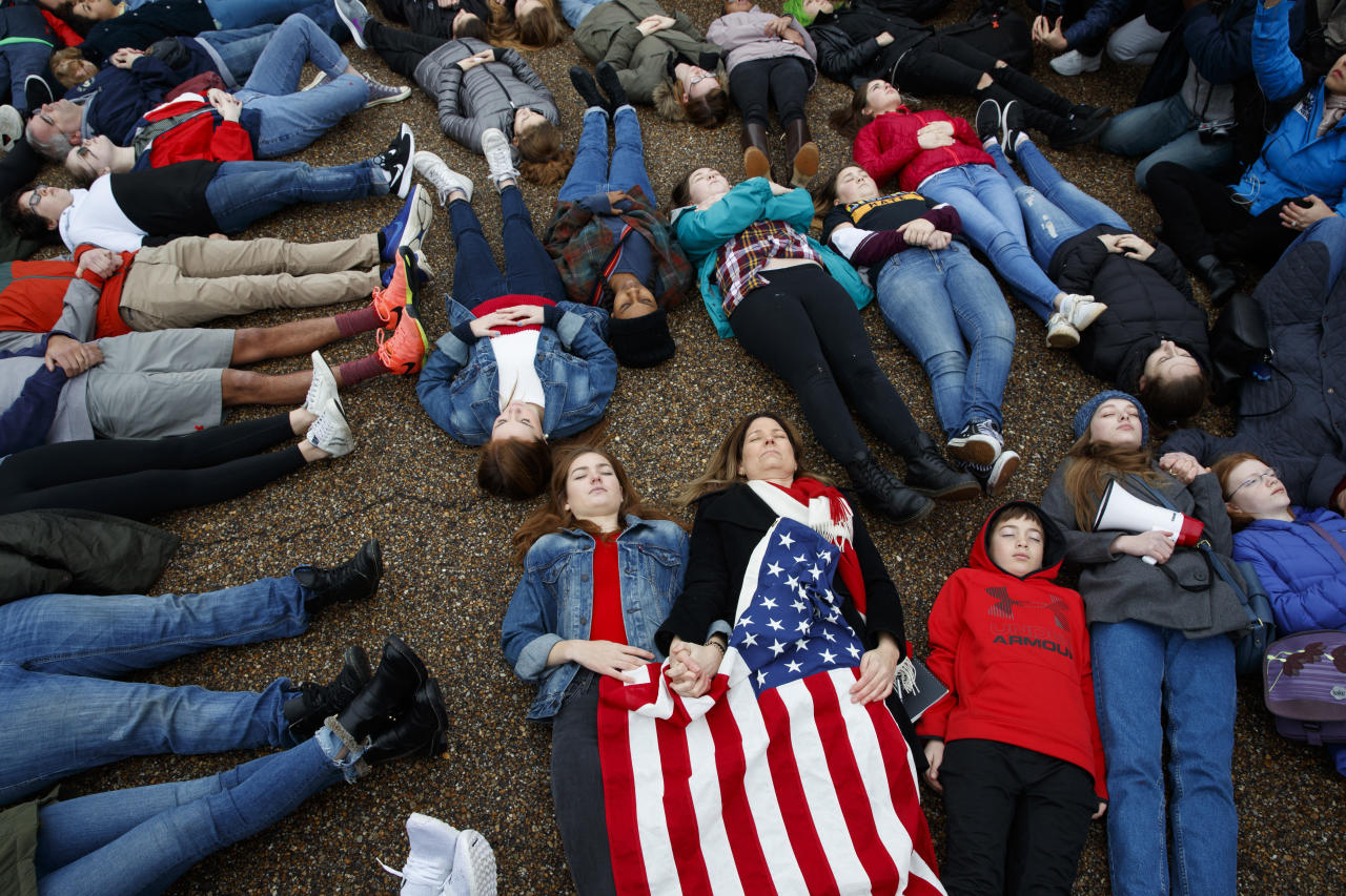 "<p>Abby Spangler and her daughter Eleanor Spangler Neuchterlein, 16, hold hands as they participate in a ""lie-in"" during a protest in favor of gun control reform in front of the White House, Monday, Feb. 19, 2018, in Washington. (Photo: Evan Vucci/AP) </p>"