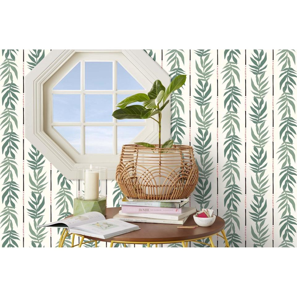 <p>We're dreaming of a tropical oasis with this <span>Drew Barrymore Flower Home Vintage Palm Green Peel & Stick Wallpaper</span> ($35).</p>