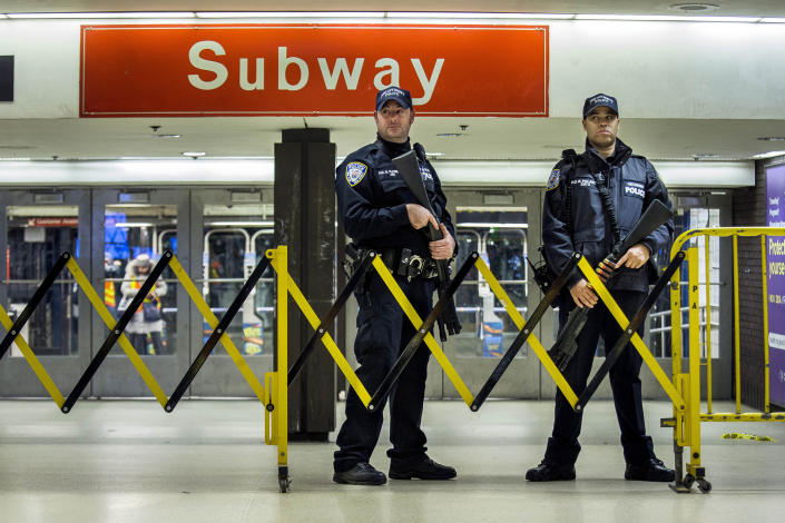 FILE - In this Dec. 11, 2017 file photo, police stand guard inside the Port Authority Bus Terminal following an explosion near Times Square, in New York. Akayed Ullah, a Bangladeshi immigrant whose subway pipe bomb mostly misfired, was sentenced Thursday, April 22, 2021, to life in prison for the 2017 attack in New York City busiest station. (AP Photo/Andres Kudacki, File)