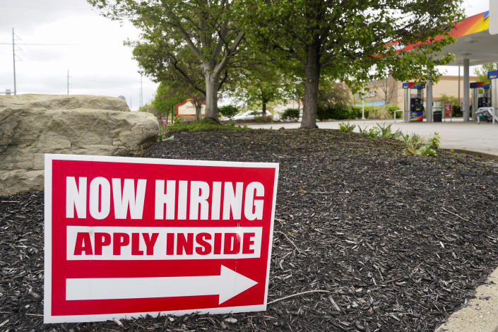 Hiring signs are posted outside a gas station in Cranberry Township, Butler County, Pa., Wednesday, May 5, 2021. (Keith Srakocic/AP)