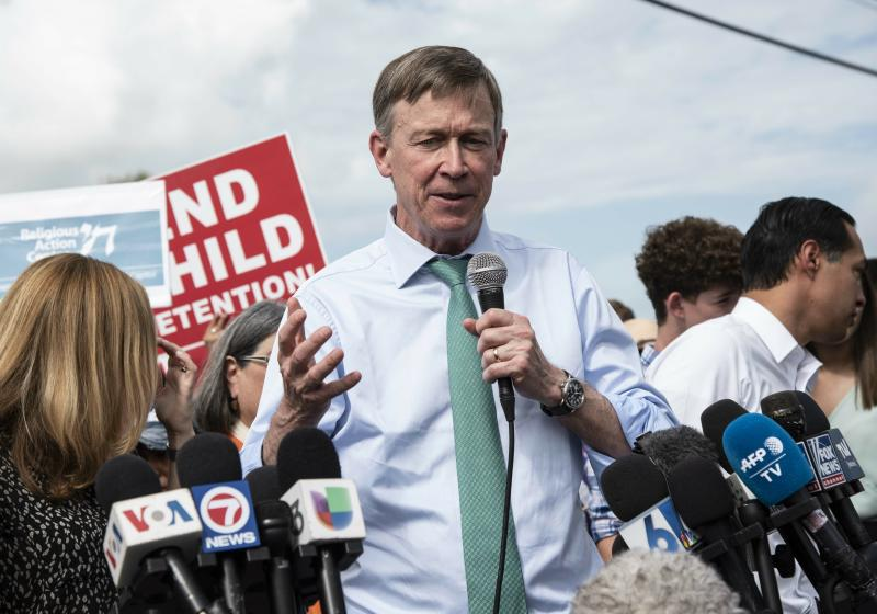Former Colorado Gov. John Hickenlooper speaks outside of the Homestead Detention Center in Homestead, Fla., last month. (Jennifer King/Miami Herald via AP)