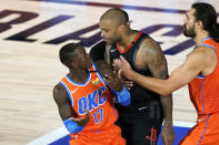 Houston Rockets' P.J. Tucker, center, his held back by Oklahoma City Thunder's Steven Adams, right, as he confronts Dennis Schroder (17) after a foul during the second half of an NBA basketball first round playoff game Saturday, Aug. 29, 2020, in Lake Buena Vista, Fla. Both players were ejected. Both Schroder and Tucker were ejected from the game. (AP Photo/Ashley Landis)