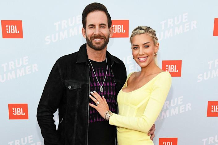 Tarek El Moussa and Heather Rae Young walk the red carpet at the JBL True Summer event.