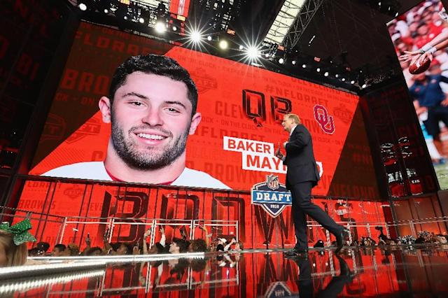 NFL Commissioner Roger Goodell walks past a video board displaying an image of Baker Mayfield of Oklahoma after he was picked #1 overall by the Cleveland Browns during the first round of the 2018 NFL Draft (AFP Photo/RONALD MARTINEZ)