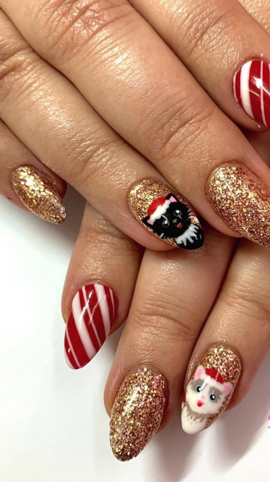"<p><a href=""https://www.instagram.com/superradnailsisters/"" rel=""nofollow noopener"" target=""_blank"" data-ylk=""slk:The Super Rad Nail Sisters"" class=""link rapid-noclick-resp"">The Super Rad Nail Sisters</a>, a boutique nail salon in Australia, created this ""Christmas kitties"" look for all the cat lovers this holiday season. Don't worry, you don't need detailed nail skills to pull off a similar manicure at home if you lean in on nail stickers.</p><p><a class=""link rapid-noclick-resp"" href=""https://go.redirectingat.com?id=74968X1596630&url=https%3A%2F%2Fwww.etsy.com%2Flisting%2F869781967%2F60-nail-decals-christmas-kittens-cats&sref=https%3A%2F%2Fwww.oprahmag.com%2Fbeauty%2Fg34113691%2Fchristmas-nail-ideas%2F"" rel=""nofollow noopener"" target=""_blank"" data-ylk=""slk:SHOP NAIL STICKERS"">SHOP NAIL STICKERS</a></p>"
