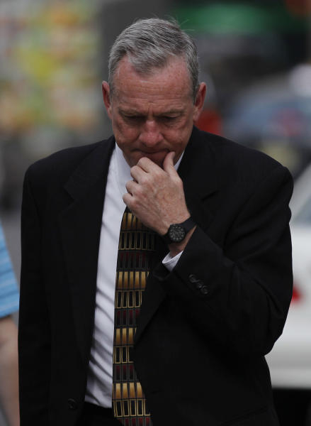 The Rev. James J. Brennan walks to the Criminal Justice Center, Thursday, June 14, 2012, in Philadelphia. Brennan is charged with the attempted rape of a 14-year-old boy in the 1990s. Brennan is on trial with Monsignor William Lynn, the former secretary for clergy in the Philadelphia archdiocese. Lynn is the first U.S. church official charged over his handling of sex-abuse complaints. (AP Photo/Matt Rourke)