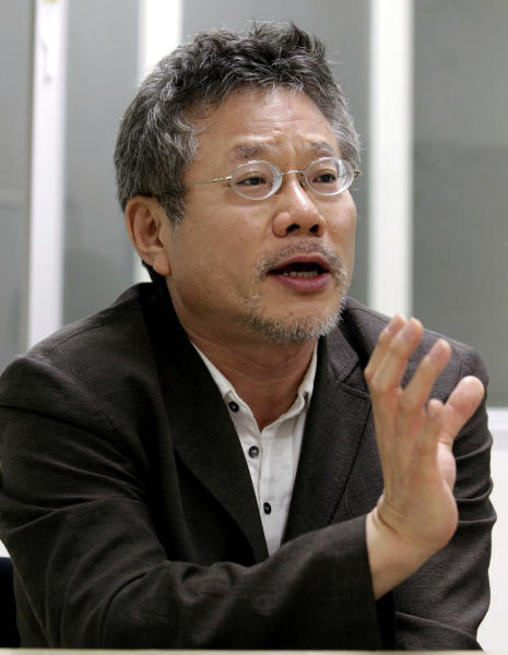 In this July 17, 2012 photo, Choi Yong-bae, Chungeoraham Film CEO and Producer, speaks during an interview with the Associated Press at his office in Seoul, South Korea. After being turned down by many investors over the last four years, Choi said it feels strange and exciting that his revenge film about a notorious South Korean president blamed for the massacre of democracy protesters is finally coming to life through online donations. (AP Photo/Ahn Young-joon)