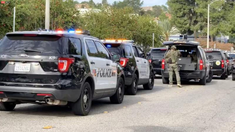 Sheriff puts on tactical gear after a shooting at Saugus High School in Santa Clarita, California