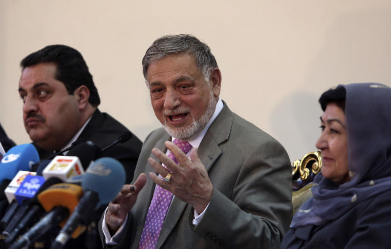 Ahmad Yousuf Nouristani, chairman of the Independent Election Commission, center speaks during a press conference in Kabul, Afghanistan, Sunday, April 13, 2014. Partial results released Sunday in Afghanistan's crucial presidential election show a tight race between ex-foreign minister Abdullah Abdullah, with 41.9 percent of the vote, and former finance minister Ashraf Ghani, with 37.6 percent. (AP Photo/Rahmat Gul)