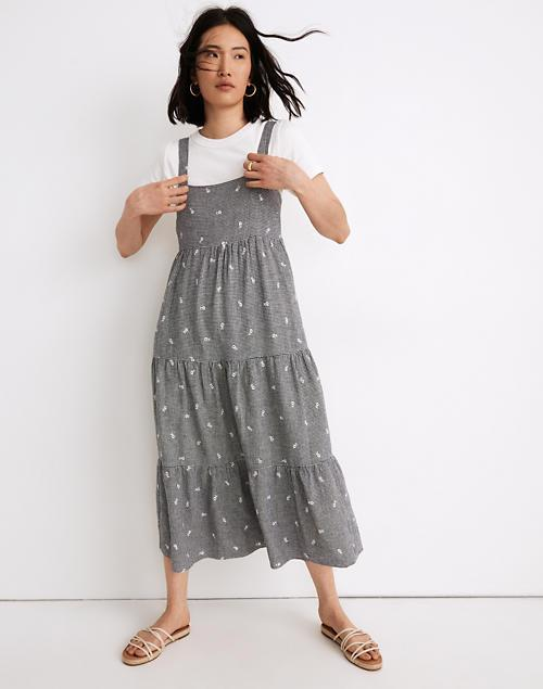 """<h2>Madewell Embroidered Tiered Midi Dress</h2><br><strong><em>The In-Betweenie </em></strong><br><br>A bit too long to be a midi and a bit too short to be a maxi, this gingham Madewell dress is for the shopper who's not ready to commit to a super-long silhouette. <br><br><strong>The Hype: </strong>4 out of 5 stars; 22 reviews on Madewell.com<br><br><strong>What They're Saying</strong>: """"The lining and thickness is great for a spring-fall dress. This print typically isn't my style but the fit was so great on that I had to go for it!"""" — Elia5, Madewell reviewer<br><br><em>Shop</em> <strong><em><a href=""""https://www.madewell.com/embroidered-tiered-midi-dress-in-gingham-check-MC966.html?color=WY7140"""" rel=""""nofollow noopener"""" target=""""_blank"""" data-ylk=""""slk:Madewell"""" class=""""link rapid-noclick-resp"""">Madewell</a></em></strong><br><br><br><strong>Madewell</strong> Embroidered Tiered Midi Dress, $, available at <a href=""""https://go.skimresources.com/?id=30283X879131&url=https%3A%2F%2Fwww.madewell.com%2Fembroidered-tiered-midi-dress-in-gingham-check-MC966.html%3Fcolor%3DWY7140"""" rel=""""nofollow noopener"""" target=""""_blank"""" data-ylk=""""slk:Madewell"""" class=""""link rapid-noclick-resp"""">Madewell</a>"""