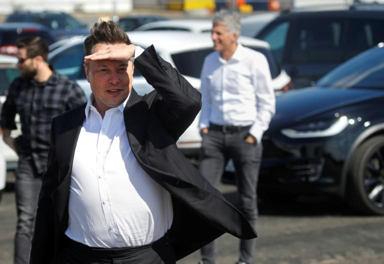 Tesla CEO Elon Musk gestures as he arrives to visit the construction site of the future US electric car giant in Gruenheide near Berlin in September