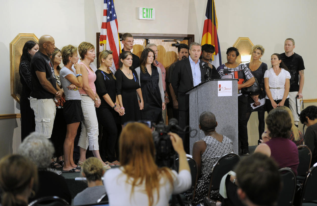 Tom Teves, at podium, group spokesman of the families of the victims of the Colorado theatre shooting, speaks during a press conference in Aurora, Colo., on Tuesday, Aug. 28, 2012. Families of some of the 12 people killed in the Colorado theater shooting are upset with the way the millions of dollars raised since the tragedy are being distributed.   (AP Photo/Chris Schneider)
