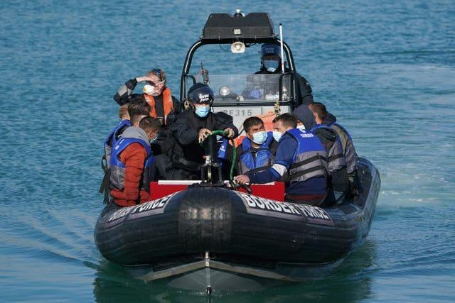 A group of people thought to be migrants are brought into Dover, Kent, following a small boat incident in the Channel
