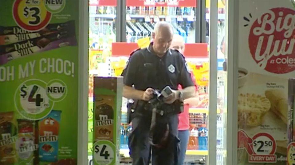 A police officer investigating after an Upper Coomera service station was allegedly held up by an 11-year-old. Photo: 7 News