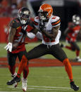 Tampa Bay Buccaneers cornerback M.J. Stewart Jr., (36) knocks a pass away from Cleveland Browns wide receiver Rashard Higgins (81) during the first half of an NFL preseason football game Friday, Aug. 23, 2019, in Tampa, Fla. (AP Photo/Mark LoMoglio)
