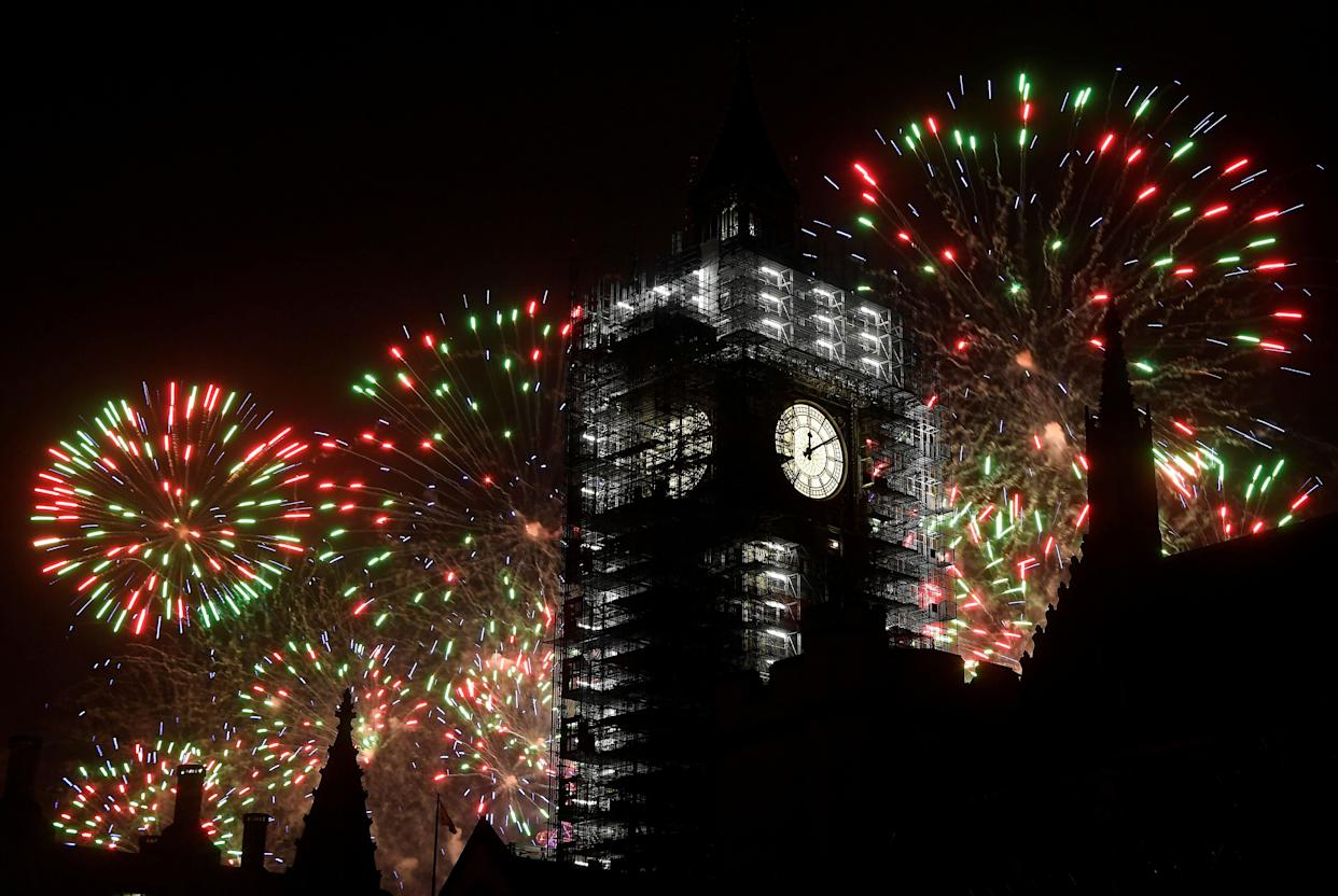 Fireworks explode behind Big Ben during New Year's celebrations in London on January 1, 2018. (Photo: Toby Melville / Reuters)
