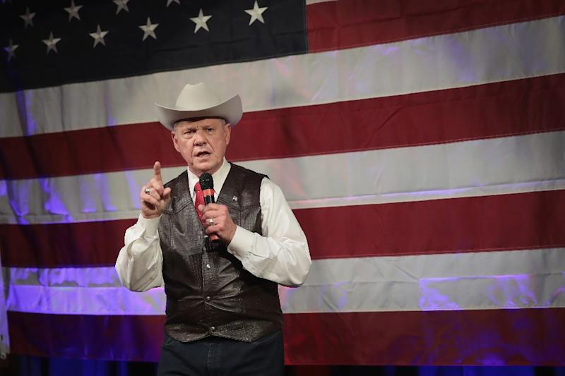 Allegations about the conduct of Roy Moore, speaking at a campaign rally in Fairhope, Alabama, have divided Republicans, but he still has President Donald Trump's backing in the race for a Senate seat (AFP Photo/SCOTT OLSON)