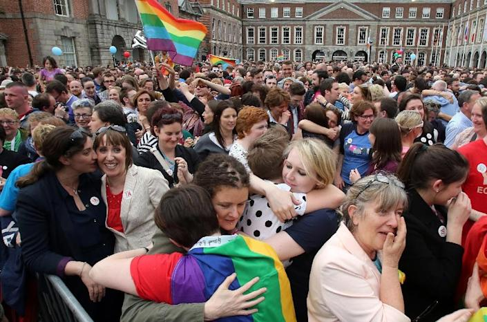 Supporters react outside Dublin Castle following the announcement of the result of the same-sex marriage referendum on May 23, 2015 (AFP Photo/Ian Kington)