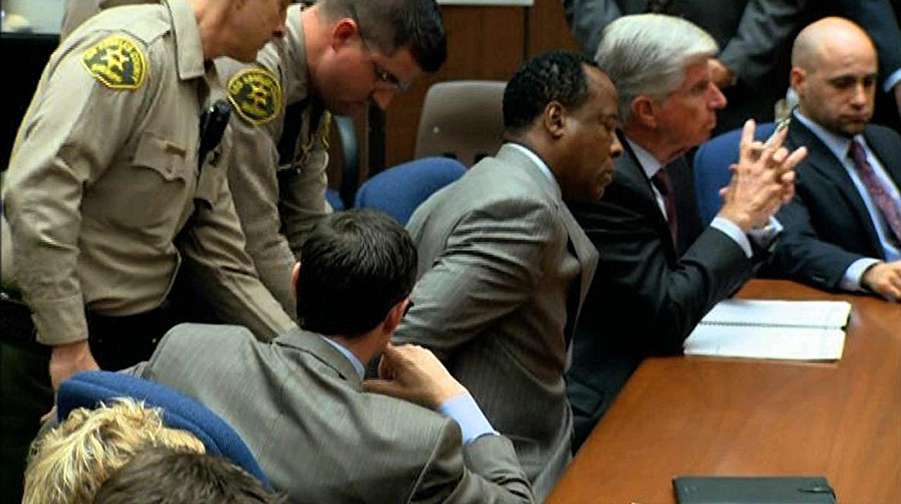 In this frame grab from video, deputies place handcuffs on Dr. Conrad Murray after his conviction on involuntary manslaughter charges in the death of pop star Michael Jackson, in Los Angeles Superior Court Monday, Nov. 7, 2011. Murray was Michael Jackson's physician when the pop star died in 2009. (AP Photo/CNN, Pool)