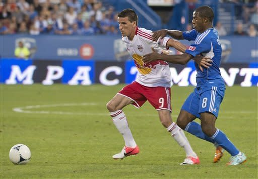 Montreal Impact's Patrice Bernier, right, tangles with New York Red Bulls' Sebastien Le Toux during the first half of an MLS soccer game Saturday, July 28, 2012, in Montreal. (AP Photo/The Canadian Press, Peter McCabe)