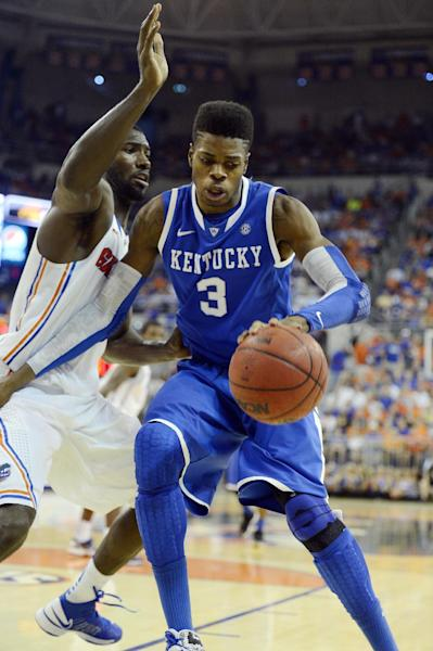 Kentucky forward Nerlens Noel (3) tries to get around Florida center Patric Young (4) during the second half of an NCAA college basketball game in Gainesville, Fla., Tuesday, Feb. 12, 2013. Florida won 69-52. (AP Photo/Phil Sandlin)