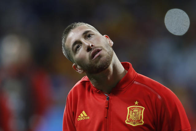FILE - In this March 27, 2018 file photo, Spain's Sergio Ramos listens to the national anthem before the international friendly soccer match between Spain and Argentina at the Wanda Metropolitano stadium in Madrid, Spain. The elegance and precise passes of Andres Iniesta, the personality and stout defense of Sergio Ramos and the intelligence and scoring touch of David Silva will all be on display again at the World Cup, but mostly likely for the last time. (AP Photo/Paul White, File)