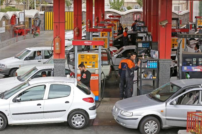 Drivers in Tehran fill up their tanks in November 2018 as the United States keeps ramping up sanctions on oil exports (AFP Photo/ATTA KENARE)