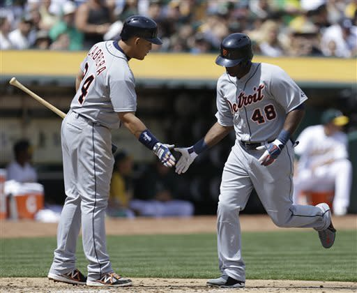 Detroit Tigers' Torii Hunter (48) is congratulated by Miguel Cabrera after hitting a home run off Oakland Athletics' Brett Anderson in the third inning of a baseball game Saturday, April 13, 2013, in Oakland, Calif. (AP Photo/Ben Margot)