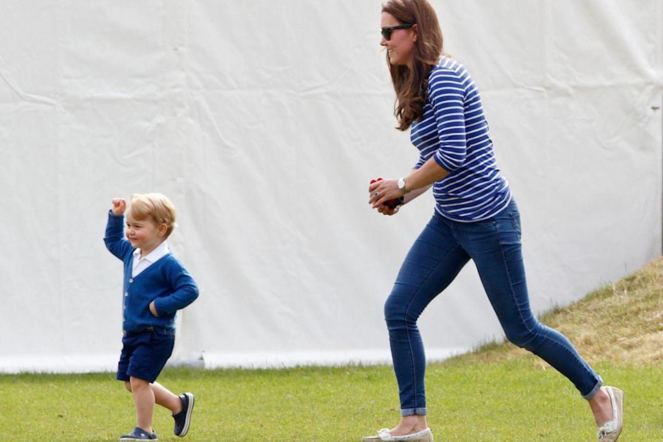 <p>Middleton chases after Prince George with toys in hand at a charity polo match in Tetbury, England.</p>