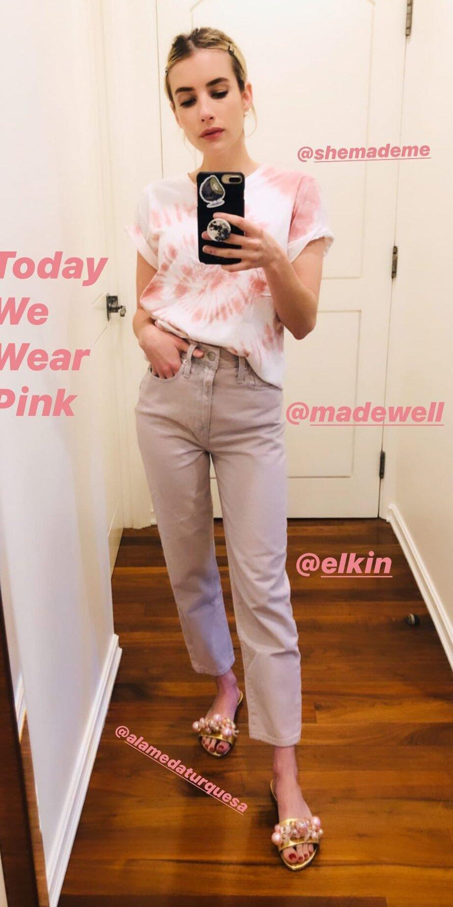 """<p>On the first Monday of May, inspired by the pink Met Gala gown of years past, Emma Roberts dressed in all pink. Her at-home look featured a pink She Made Me tie-dye t-shirt (<strong>Shop similar: </strong>$45; <a href=""""http://www.anrdoezrs.net/links/7799179/type/dlg/sid/IS%2CEmmaRoberts%2Canesta%2C%2CIMA%2C3545496%2C202005%2CI/https://www.jcrew.com/us/p/womens_category/maternity/tshirts_tanktops/vintage-cotton-crewneck-tshirt-in-tiedye/AJ578?"""" rel=""""nofollow noopener"""" target=""""_blank"""" data-ylk=""""slk:jcrew.com"""" class=""""link rapid-noclick-resp"""">jcrew.com</a>), Madewell boot-cut jeans (<strong>Shop now: </strong>$135; <a href=""""http://www.anrdoezrs.net/links/7799179/type/dlg/sid/IS%2CEmmaRoberts%2Canesta%2C%2CIMA%2C3545496%2C202005%2CI/https://www.madewell.com/slim-demi-boot-jeans-in-cloud-lining-AJ198.html"""" rel=""""nofollow noopener"""" target=""""_blank"""" data-ylk=""""slk:madewell.com"""" class=""""link rapid-noclick-resp"""">madewell.com</a>), and embellished Alameda Turquesa slides (<strong>Shop similar:</strong> $216; <a href=""""https://click.linksynergy.com/deeplink?id=93xLBvPhAeE&mid=42352&murl=https%3A%2F%2Fwww.shopbop.com%2Fcrystal-pearl-slide-mystique%2Fvp%2Fv%3D1%2F1505331120.htm%3F&u1=IS%2CEmmaRoberts%2Canesta%2C%2CIMA%2C3545496%2C202005%2CI"""" rel=""""nofollow noopener"""" target=""""_blank"""" data-ylk=""""slk:shopbop.com"""" class=""""link rapid-noclick-resp"""">shopbop.com</a>).</p>"""