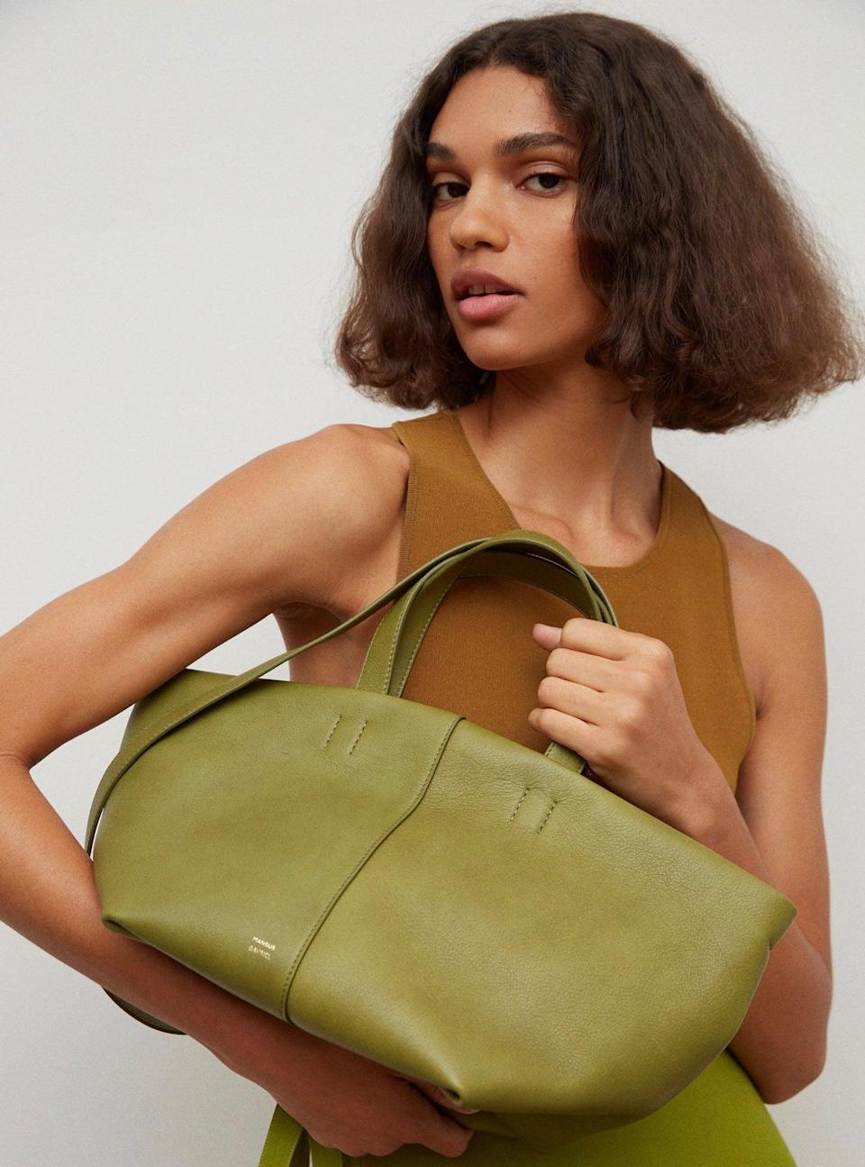 <p>The <span>Mansur Gavriel Tulipano Bag</span> ($695) is a polished choice for spring picnics or outdoor happy hours.</p>