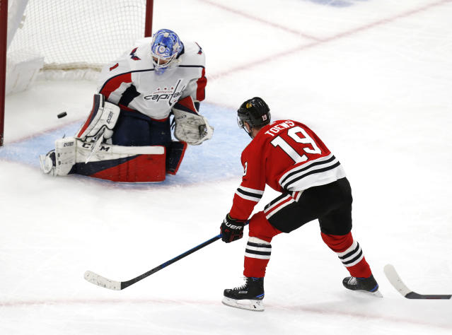 Chicago Blackhawks center Jonathan Toews (19) scores past Washington Capitals goaltender Pheonix Copley (1) during the third period of an NHL hockey game Sunday, Jan. 20, 2019, in Chicago. (AP Photo Nuccio DiNuzzo)
