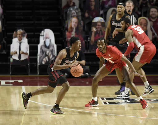 Temple's Jeremiah Williams, left, dribbles around Houstons's DeJon Jarreau (3) in the first half of an NCAA college basketball game, Saturday, Jan. 23, 2021, in Philadelphia. (AP Photo/Michael Perez)