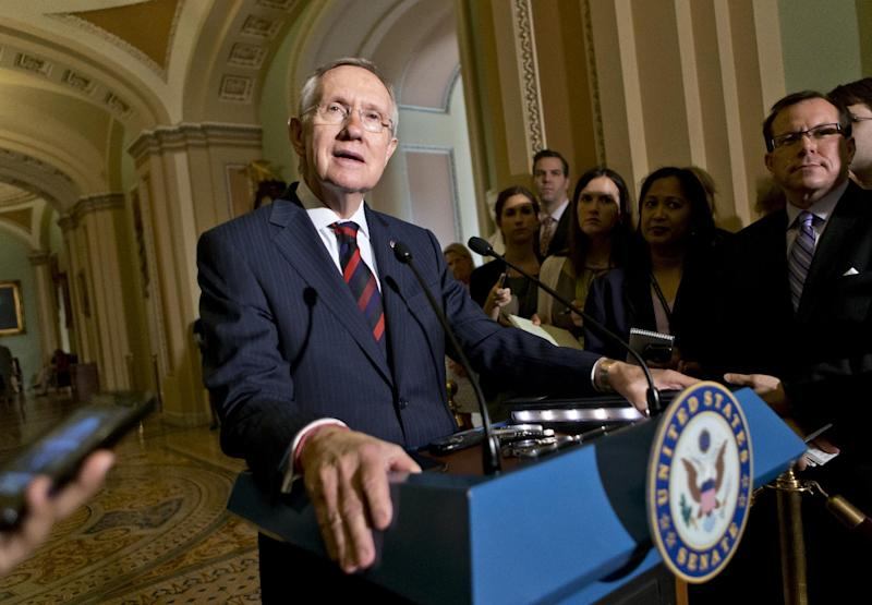 Senate Majority Leader Harry Reid of Nev., updates reporters on the pace of the immigration reform bill following a Democratic strategy session, Tuesday, June 25, 2013, on Capitol Hill in Washington. (AP Photo/J. Scott Applewhite)