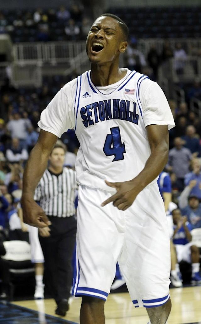 Seton Hall's Sterling Gibbs (4) celebrates after scoring during the second half of a Coaches vs. Cancer NCAA college basketball game against Oklahoma, Friday, Nov. 22, 2013, in New York. (AP Photo/Frank Franklin II)