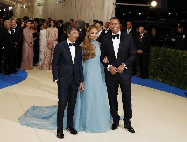 Metropolitan Museum of Art Costume Institute Gala - Rei Kawakubo/Comme des Garcons: Art of the In-Between - Arrivals - New York City, U.S. - 01/05/17 - (L-R) Pierpaolo Piccioli, Jennifer Lopez and Alex Rodriguez. REUTERS/Lucas Jackson