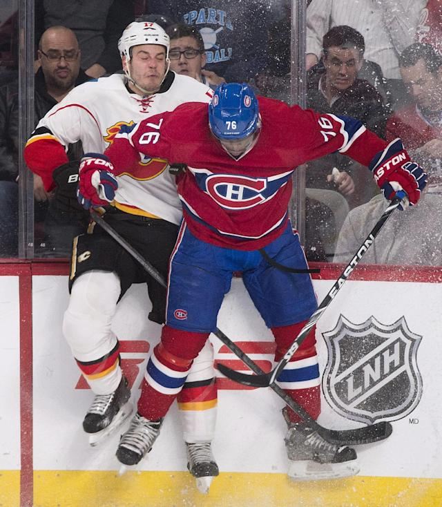 Montreal Canadiens' P.K. Subban, right, collides with Calgary Flames' Lance Bouma during the first period of an NHL hockey game Tuesday, Feb. 4, 2014, in Montreal. (AP Photo/The Canadian Press, Graham Hughes)