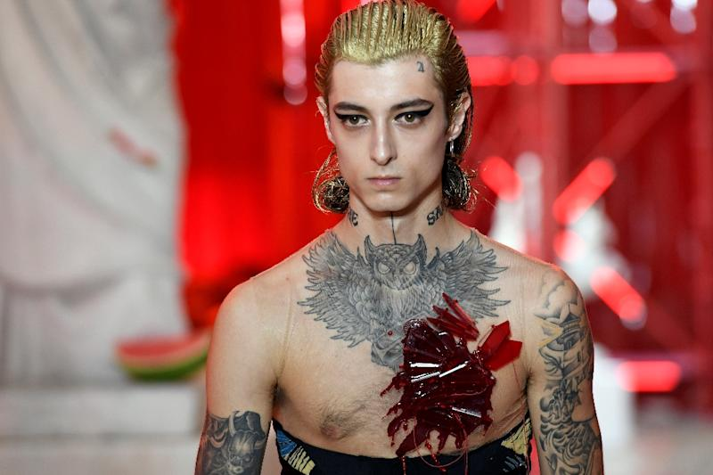 "Margiela's John Galliano said the time had come to ""liberate"" men from their sartorial shackles. For him that meant silks and satins, daring to be ""louche"" by going shirtless under a suit, and most of all wearing clothes cut on the bias -- the technique he has used for years to make his clothes for women so fluid and sensual (AFP Photo/BERTRAND GUAY)"