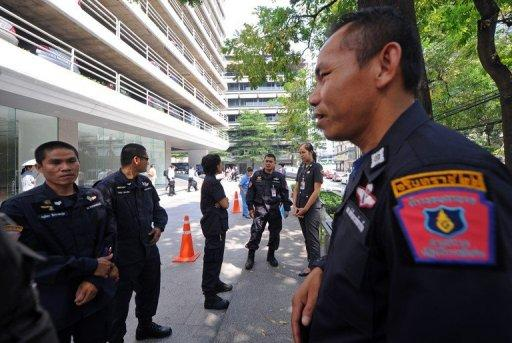 Thai police stand guard near the main entrance of the building housing the Israeli embassy in Bangkok