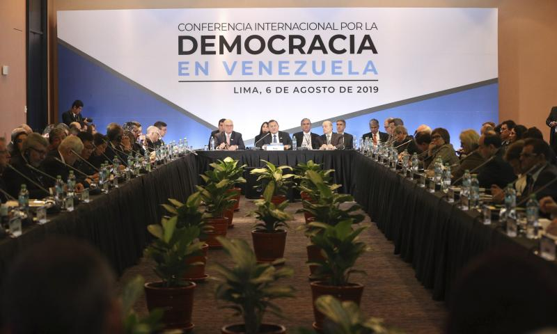 Peru's Foreign Ministry Nestor Nestor Popolizio, center, speaks during the inauguration of a conference of more than 50 nations that largely support Venezuelan opposition leader Juan Guaido in Lima, Peru, Tuesday, Aug. 6, 2019. During the meeting National Security Adviser John Bolton says the U.S. will target anybody at home or abroad who supports the government of Venezuelan President Nicolas Maduro with stiff financial sanctions. (AP Photo/Martin Mejia)