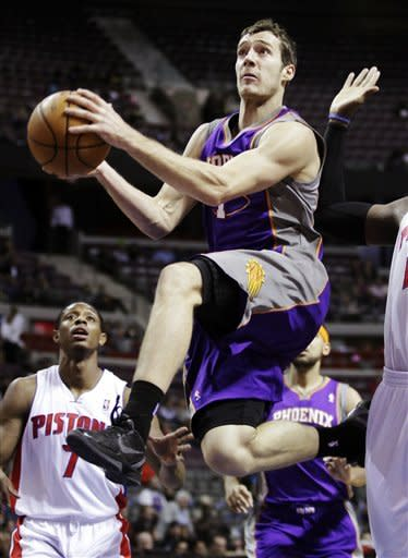 Phoenix Suns guard Goran Dragic (1) goes to the basket past Detroit Pistons guard Brandon Knight (7) in the first half of an NBA basketball game, Wednesday, Nov. 28, 2012, in Auburn Hills, Mich. (AP Photo/Duane Burleson)