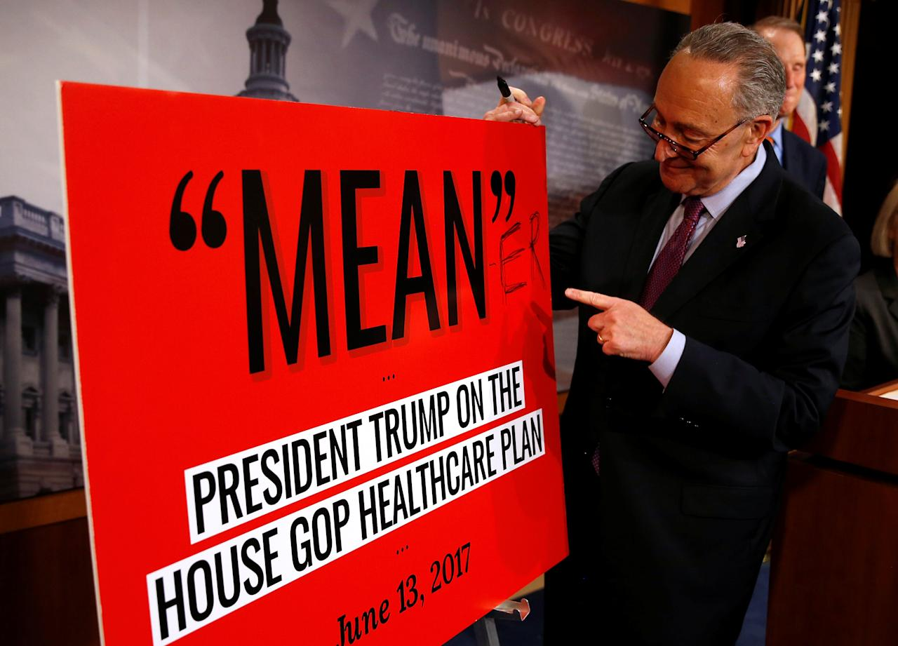 Senate Minority leader Chuck Schumer (D-NY) points to a sign after Senate Republicans unveiled their version of legislation that would replace Obamacare on Capitol Hill in Washington, U.S., June 22, 2017.   REUTERS/Joshua Roberts