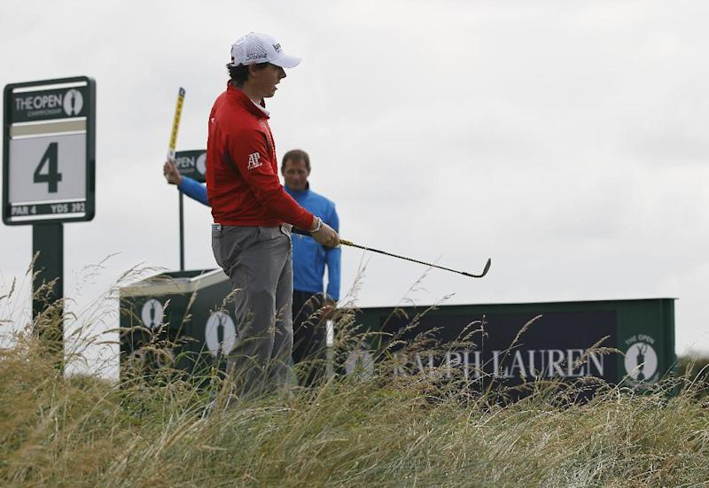 Rory McIlroy of Northern Ireland chips onto the third green from the fourth tee box at Royal Lytham & St Annes golf club during the second round of the British Open Golf Championship, Lytham St Annes, England, Friday, July 20, 2012. (AP Photo/Tim Hales)