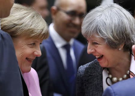 British Prime Minister Theresa May and German Chancellor Angela Merkel attend  the EU summit in Brussels, Belgium, March 9, 2017. REUTERS/Yves Herman
