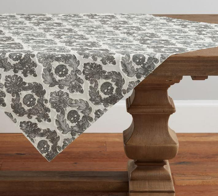 <p>Elevate your dining table's spook factor with this <span>Skull Embroidered Damask Cotton Table Throw</span> ($149).</p>