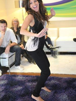 <p>Ashley prefers to break out a dance move barefoot!</p>