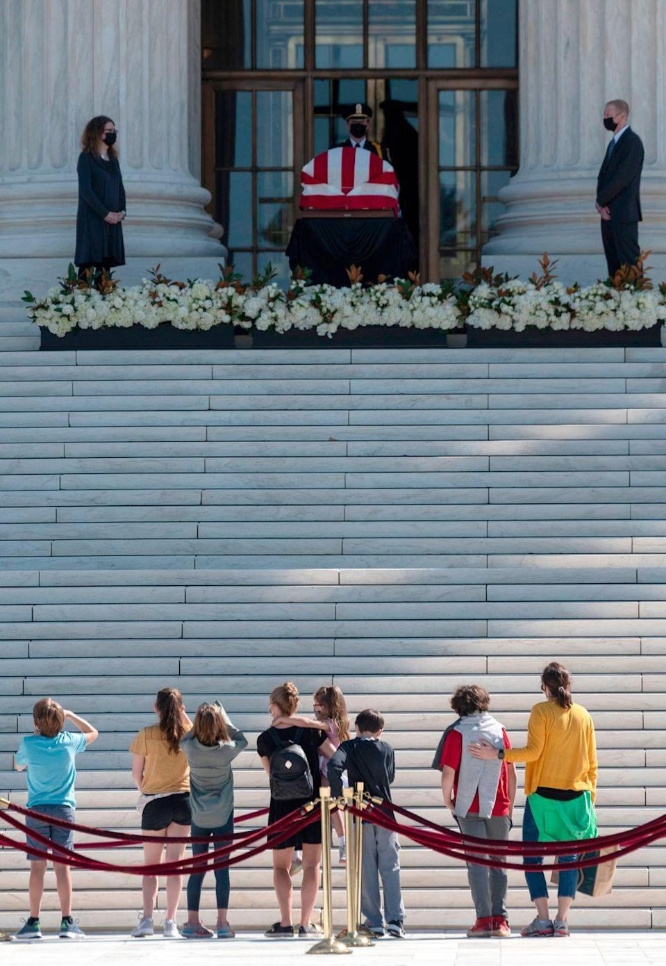 <p>People pay respects as Justice Ruth Bader Ginsburg lies in repose in front of the US Supreme Court in Washington, DC on September 23, 2020.</p>