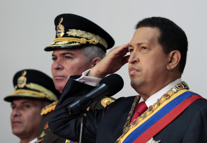 ** CORRECTS NAME OF PHOTOGRAPHER ** In this photo provided by Miraflores Presidential Press Office,  Venezuela's President Hugo Chavez gestures during an event commemorating Venezuela's 200 years of independence at Miraflores palace in Caracas, Venezuela, Tuesday July 5, 2011.  Venezuela declared its independence from Spain in 1811.  (AP Photo/Miraflores Presidential Press Office)
